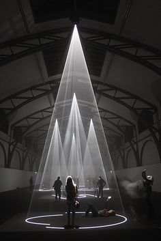The light and sound installation Five Minutes of Pure Sculpture by British artist Anthony McCall Visitors at the Hamburger Bahnhof Museum