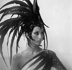 you could always count on Cher for a unique headress!