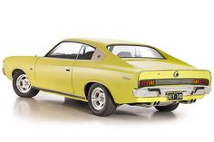 OZ VH 340 Chrysler Valiant Charger design by Bob Hubbach -rear -angle -left Chrysler Charger, Chrysler Cars, Australian Muscle Cars, Aussie Muscle Cars, Chrysler Valiant, Old School Muscle Cars, Big Girl Toys, Van Car, Unique Cars