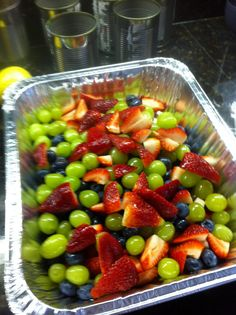 Fruit Salad with Honey-Lime Dressing - Easy- Yield: enough for a crowd: Rinse 1pt container strawberries, 1pt container blueberries & 1 bunch (abt 1.5 lbs) seedless grapes (green, red or mixture of both). Gently pat fruit dry. Hull strawberries, cut in half; if large, cut into quarters. Remove stems from blueberries. Remove grapes from stems. Gently combine fruit in large bowl or aluminum tray. Set aside. In small bowl, whisk together 1/4c honey & juice from 2 limes (abt 2-3T). Pour over fruit.