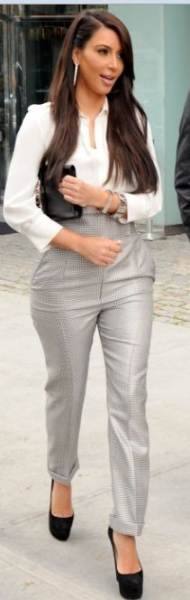 Shirt and pants – Alexander McQueen    Shoes – Christian Louboutin    Purse – Hermes