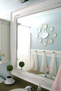 "-using vinyl for ""wall paper"" inside picture molding.  -love the idea of using plates on the wall...maybe good for kitchen or guest bathroom.  -love hardware for towl hanging"