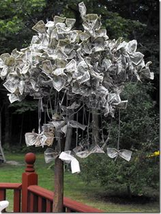 """Money Tree - All money goes to bride-to-be, guests tie money to the """"money"""" branches as their gift."""