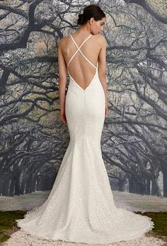 Brides: Nicole Miller. Mermaid gown made of floral corded lace. Scalloped open V-back with crisscross slim straps.