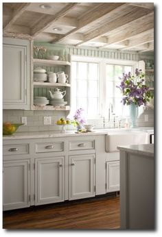 BHG - Cottage kitchen with seafoam green painted beadboard walls, white kitchen cabinets Keywords: Designer Kitchens, Cabinet Hardware Ideas, Paint Colors For Kitchen Cabinets, Cabinet Updates, Cabinet Designs, Furniture Hardware Ideas, Easy Inexpensive Kitchen Renovations