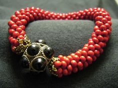 Bead crochet bracelet with china red beads.