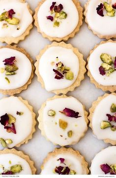 Beautiful little bites of rose water and cardamom made with almond flour and topped with rose petals and pistachios! https://www.theprettyblog.com/food/rosewater-and-cardamom-biscuits/