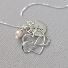 Delicate and Dainty Personalized Sterling Silver Heart Necklace with Swarovski Pearl Charm PEARLS AVAILABLE IN OTHER COLORS: May also be replaced with crystals. Please see color charts for options and kindly note on check-out your preferences. MORE HEART NECKLACES IN THE STORE: https://www.etsy.com/shop/alexandreasjewels/search?search_query=HEART+NECKLACE&order=date_desc&view_type=list&ref=shop_search Necklace default length: 16 inch...