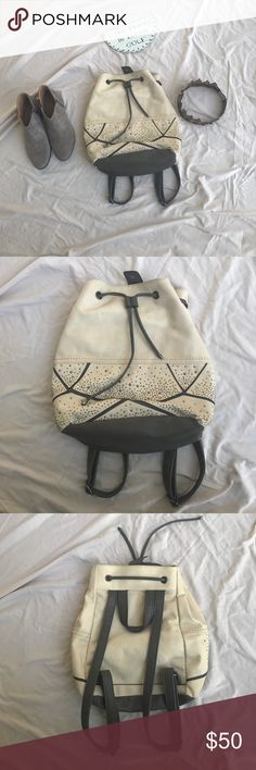 Back pack purse Beautiful bag, with back pack straps, one tiny black spot, needs cleaned off, other than that the studs are all in tact, there is no cracking, the inside is super clean, carried twice, medium size bag Buckle Bags Hobos