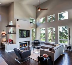Contemporary Great Room with Dark hardwood floors, Bent plywood breakfast table, Electric fireplace, Paint