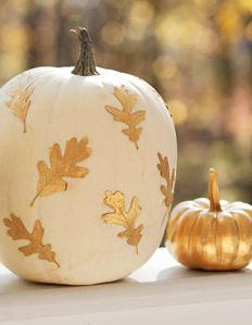 white pumpkins with gold leaves for autumn