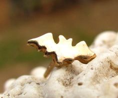 Super Sale/ ONE Tiny 14K Gold Bat Stud by diggersgoldjewelry, $55.00 Just one gold bat stud.