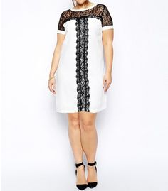 Short sleeve, A line mini dress with white neck and sleeve trim, lace insert top section and center lace detail.  Length:36 Inch, Bust:47 Inch, Waist:45 Inch Size: 2X/3X  Color: White/Black  100% Polyester  Made in China 35.00USD