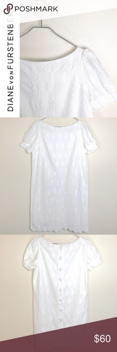"Diane Von Furstenberg White Shift Dress Diane Von Furstenberg White Shift Dress with embroidered diamond pattern. Buttons up the back. Puff sleeves. Scalloped bottom hem. 36"" from neckline to hem. 20"" bust. Small yellow stain on back as shown in pic 4. Barely visible. Great condition. Size 12. Diane von Furstenberg Dresses Midi"
