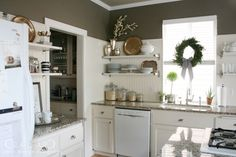 indoor kitchen wreath, shiny silver things displayed
