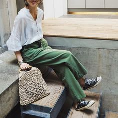 White blouse, green trousers, black Converse & knitted bag | @styleminimalism