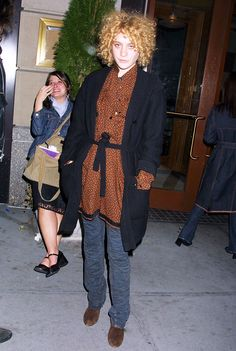 Chloë Sevigny in tie-waist cardigan and blouse