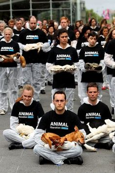 Animal Liberation Victoria activists hold dead animals at Federation Square on October 1, 2013 in Melbourne, Australia. Over 200 activists g...