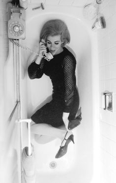 Joan Rivers on the phone in a bathtub - Los Angeles - photographed by Harry Langdon.
