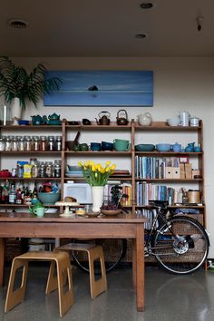 love the mix of cermic, glassware, and books on these kitchen shelves(sirima sataman via design sponge)