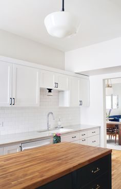 Our Eastmoreland Pendant + Mission Hardware + Hannah Flush Mount + Hood Pendant are a delicious combination in this DIY design by Yellow Brick Home.