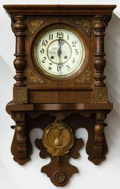 Lot 151: Mahogany Wall Clock; Having an Adler Gong style with printed face, decorative pendulum, key and brass insets