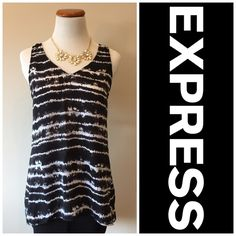 Hi/Lo Express Top Hi/lo Express top in black and white   Preowned   in excellent condition   worn once   made of polyester Express Tops
