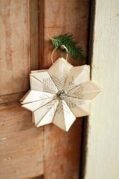 LOVE this sweet paper snowflake Christmas decoration :: Holiday decorating tips from the experts - New Hampshire Magazine - December 2016 Holiday Decorating, Decorating Tips, Christmas Decorations, Book Page Art, Book Pages, Book Crafts, Paper Crafts, Paper Snowflakes, Papercutting