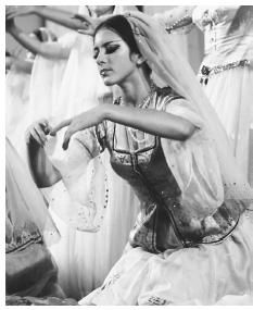 An Azerbaijani folk dancer performs a traditional dance.