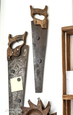 Old saw magnetic boards / A rusty tool themed work station for organizing tools and office gear / funkyjunkinteriors.net