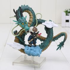 Dragon Ball little kid Goku and Shenron action figure. Size: 10cm. Packed in box. We pay the shipping for you§ Visit us for more anime and mangas products.