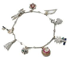 A charm bracelet like this...not too cluttered or bulky, with only meaningful charms. Platinum Charm Bracelet