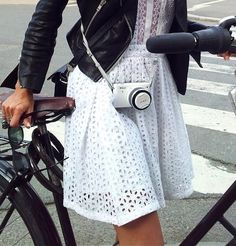 I don't agree with bike riding in a dress, but this white eyelet dress + black leather jacket is fab