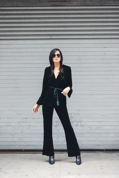 """The luxe fabric is worn best in darker hues; think emerald, navy, and burgundy. You're bound to make a statement, especially for holiday festivities."" -@weworewhat, in an H&M velvet blazer & pants 