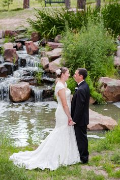 Black Forest Colorado Lodge at Cathedral Pines wedding, Bride and Groom in front of the cascading waterfall.  Andrew loves Danielle Photos by Katie Corinne Photography