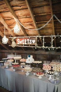 Dessert bars are wildly popular these days. A dessert table is a good idea to amaze your guests as a fun, interactive and delicious addition to the wedding reception. Once you have decided to have a dessert table, you. Wedding Desserts, Mini Desserts, Wedding Cakes, Wedding Dessert Bars, Wedding Foods, Party Desserts, Wedding Cupcakes Display, Wedding Candy Buffet, Cookie Bar Wedding