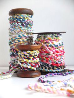 Twist Fabric Scraps into Colorful Twine | Make:  Could probably do this on the spinning wheel.