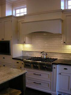 Design Moe - kitchens - beveled subway tiles, beveled subway tile backsplash, paneled range hood, two tone countertops, black countertops, granite countertops,