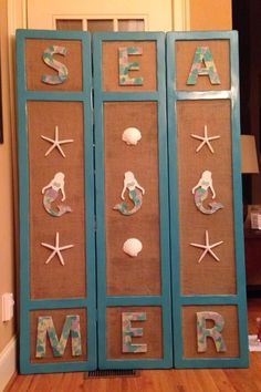 AFTER -  DIY Upcycled, repurposed old, ugly room divider for beach house BEACHY WALL ART I MADE FROM AN OLD ROOM DIVIDER #turquoise #sea glass #beach glass #mermaids #beachy #beach #cottage #DIY #starfish #shells #beach decor #refinished #burlap #Tybee Island
