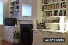 Bit fancier than us, but like the fireplace! Alcove Cupboards, Cabinet Makers, Cupboard Ideas, Living Room Designs, Bookcase, New Homes, Mid Century, Lounge, The Unit