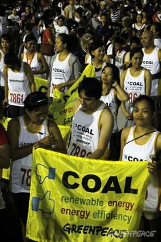 Greenpeace volunteers join the thousands of advocates from other NGOs and community groups for the Anti-Coal Fun Run in Olongapo City organized by Sikad Subic, an organization that campaigns against the setting-up of coal fired power plants in the city.