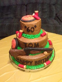 60th birthday skeet shooting trap cake shotgun shell clay targets...I made this cake for my dad's surprise 60th birthday party! It was a real hit!