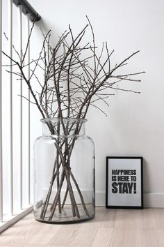Simple to make and stylish. Just get some nice dry tree branches and put the m in big glass jar!