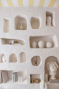 shelves carved into stucco wall filled with books, ceramics, and a bust - interior details  IMAGES, GIF, ANIMATED GIF, WALLPAPER, STICKER FOR WHATSAPP & FACEBOOK