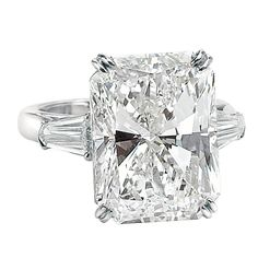 An Impressive 15.03 ct Radiant Cut Diamond GIA Cert Ring. This magnificent handmade Platinum Ring is set with a 15.03ct Radiant cut G/SI1 diamond accompanied with a GIA Cert.  Flanked by a matching pair 1.00tw Tapered Baguettes.  David Rosenberg is President of the Diamond Bourse of the Southeastern United States and is a worldwide recognized expert in his field. $1,750,000