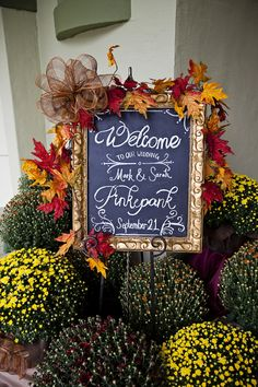 Fall, Vintage, antique decor with a colorful spin using mums, fall leaves,  chalkboard, and gold antique frames.