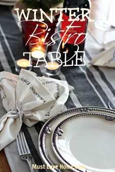 Be inspired to sit down to a casual meal at this pretty Winter Bistro Table. Clever wine glass tags and Napkins add personality to this neutral table.