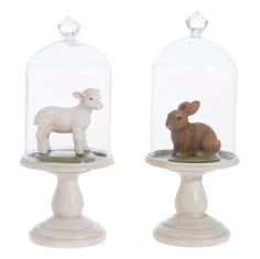 Bunny and Lamb cloche.  Resting on vintage white pedestal stands and topped with dome glass, a little lamb and brown rabbit will decorate your home for Easter, spring or everyday. Shelley B Home and Holiday.com