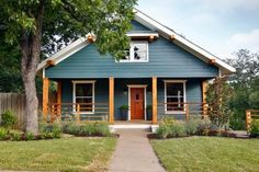 Cool slate-blue exterior with white trim, new porch railing and warm wood accents make for a striking redress for the home's exterior.