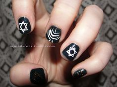 Hanukkah nails.  Here is some Hannukah nail art for you.  There is a menorah and some stars of david.  I tried making gelt on the pinky but I didn't like how it came out.    Polish used: Zoya Cynthia, Inglot 29, Sinful Colors Flower Girl